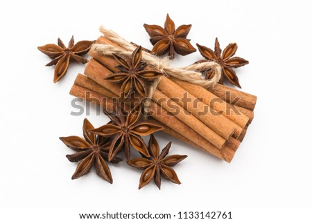 Cinnamon sticks and cardamom on a white background. Aromatic spices. #1133142761