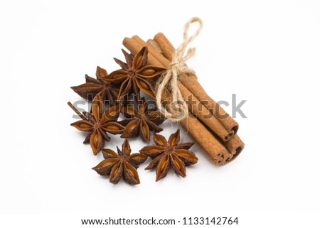 Cinnamon sticks and cardamom on a white background. Aromatic spices. #1133142764
