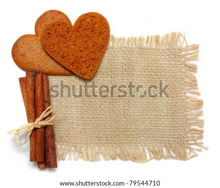 Cinnamon sticks and cookies on sack