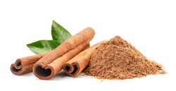 Cinnamon sticks and ground with fresh leaves on a white background. Isolated
