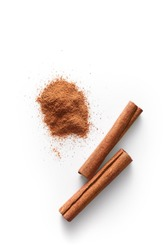Cinnamon sticks and grounded cinnamon isolated on a white background. Cinnamon spice powder viewed from above. Top view.