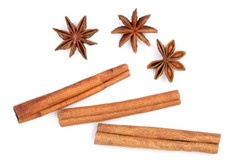 Cinnamon sticks and star anise isolated on white background. Top view