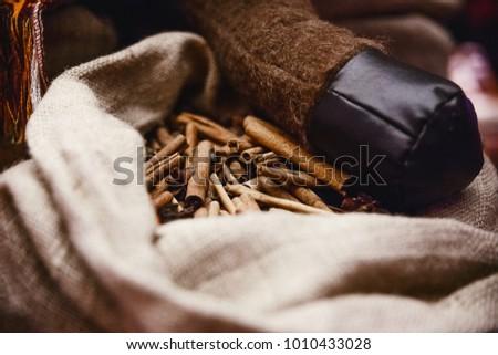 cinnamon sticks in a fabric bag, Oriental spices, Oriental fragrance #1010433028