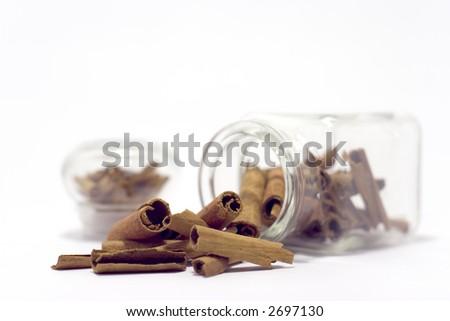 cinnamon sticks in bottle isolated on white