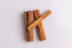 Cinnamon sticks isolated on white background, copy space, studio shot, soft light, top view.  Latin name  Cinnamomum cassia