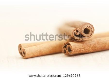Cinnamon sticks isolated on white background  (Shallow DOF)