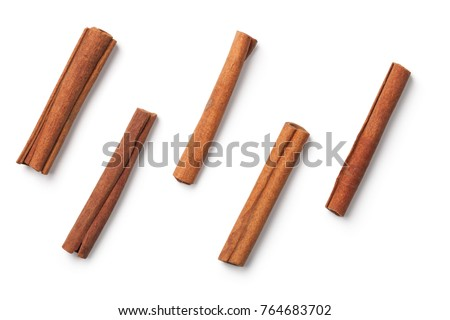 Cinnamon sticks isolated on white background. Top view #764683702