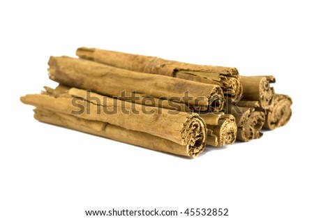 Cinnamon sticks isolated over a white background.