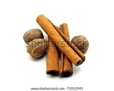 Cinnamon sticks & nutmegs on a white background
