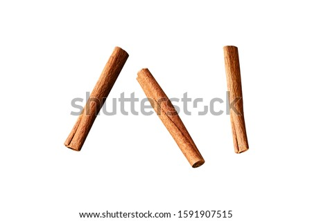 Cinnamon sticks on a white background. Cinnamon sticks in different sizes and shapes isolated