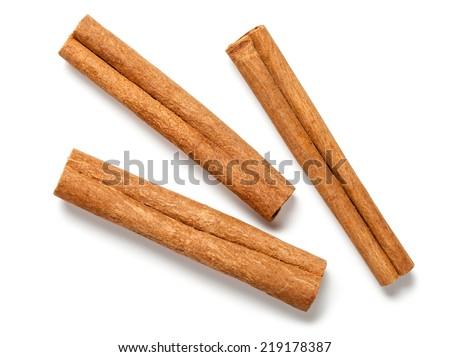 Cinnamon sticks on white background. Top view