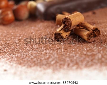 cinnamon sticks over cocoa powder