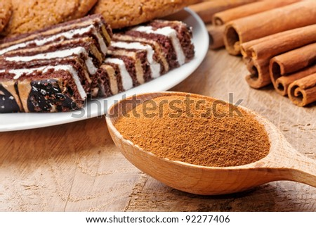Cinnamon with sweets on the wood surface