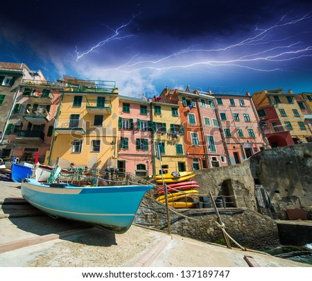 Cinque Terre. Beautiful view of the port with boats and colourful homes.