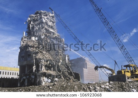 CIRCA 1990 = A demolition crew tearing down remnants from a building in Minneapolis, Minnesota