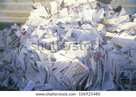 CIRCA 1988 - A pile of newspaper waiting for recycling in a bin at the Santa Monica Community Center, CA