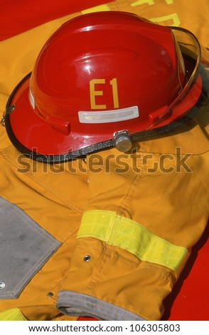 CIRCA 1989 - Detail of a Beverly Hills firefighter's red helmet and yellow jacket