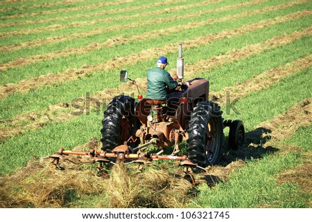 CIRCA 1999 - Farmer on tractor in field USA