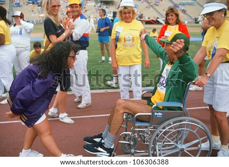 CIRCA 1989 - Man in wheelchair at finish line, Special Olympics at UCLA, Los Angeles, California