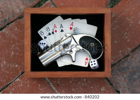 """Circa 1889, Model 95, Type II Model 3 Double Derringer in its wooden display box on black velvet with aces and eights aka a """"Dead Mans Hand"""" and dice showing 9 - stock photo"""