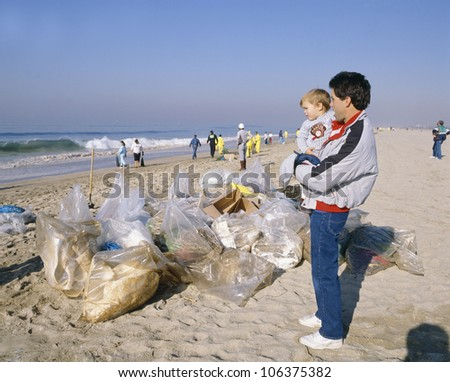 CIRCA 1990 - Oil spill cleanup at Newport Beach, California