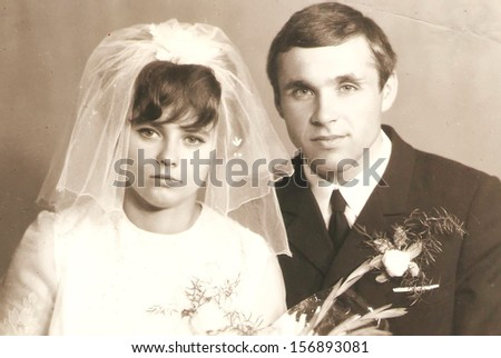 CIRCA 1920: original antique wedding photo. portrait of just married couple. nostalgic picture, circa 1920