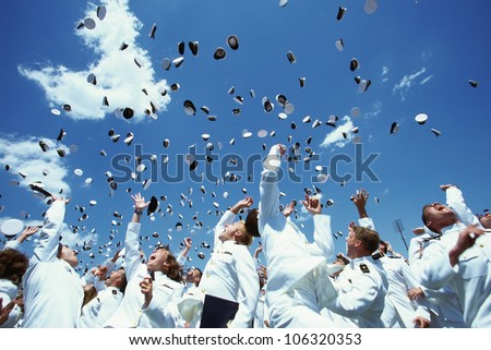 CIRCA 1999 - This is the United States Naval Academy Graduation Ceremony. The shows the graduating Naval Cadets during the famous tossing of hats in the air. Their uniforms and hats are all white.