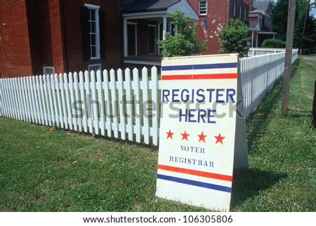 CIRCA 1998 - Voter registration sign with white picket fence, Buckingham, Virginia