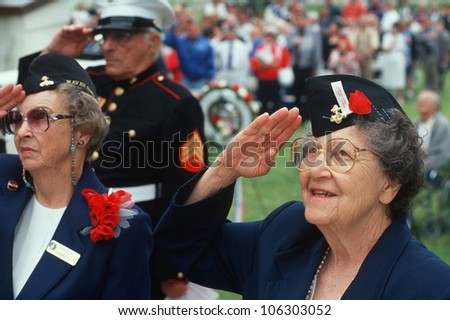 CIRCA 1998 World War II Women Veterans saluting at ceremony at Veteran's National Cemetery Los Angeles California