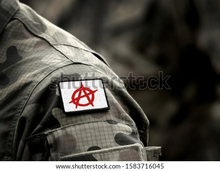 Circle-A symbol for anarchy on military uniform. Anarchist symbolism. Anarchism red Circle-A
