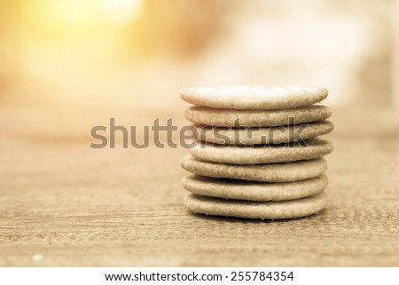 Circle biscuit stack on table. Vintage filter