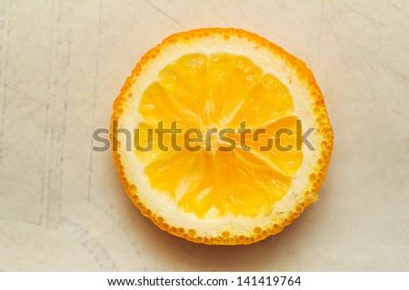 circle cutting orange segment lying on a table