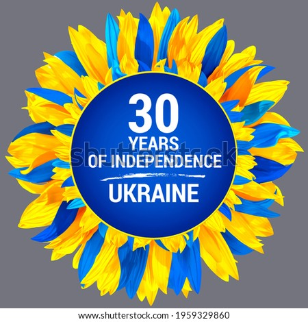Circle frame, decorated with sunflower petals in colors of Ukraine flag. Ukraine Independence Day. Wreath made of blue and yellow sunflower petals