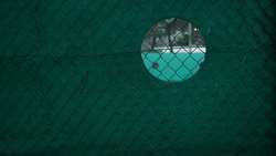 Circle Hole on the Tennis court wall