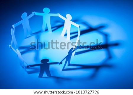 circle joining of paper figure on blue light background. in concept of business, cooperation and creativity.