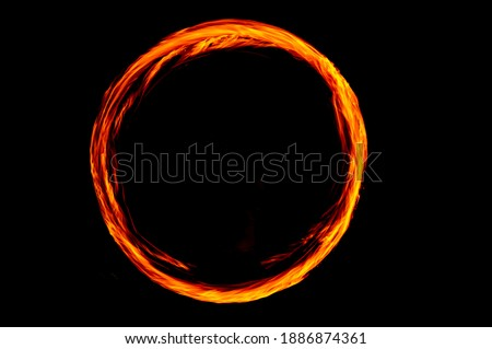 Circle of Fire flame with movment isolated on black isolated background - Beautiful yellow, orange and red and red blaze fire flame texture style. Foto stock ©