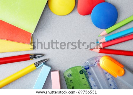 Circle of pens, pencils, chalks, rulers and exercise books
