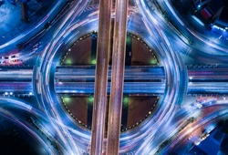 Circle of Traffic light tail seem like electron that is a heart of infrastructure road and economic system transportation and communication