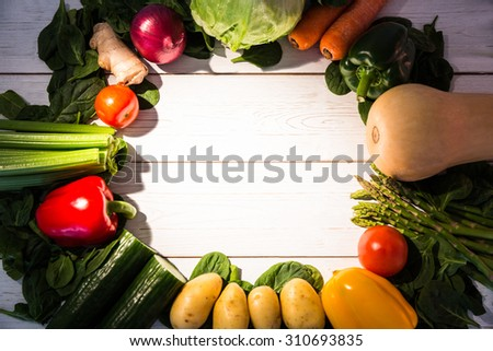 Circle of vegetables on table shot in studio