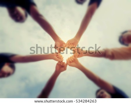 Circle shape hand of team abstract blur and color background. #534284263