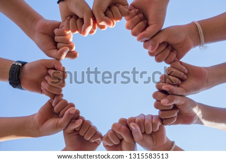 Circle shape hand of team showing unity and teamwork #1315583513