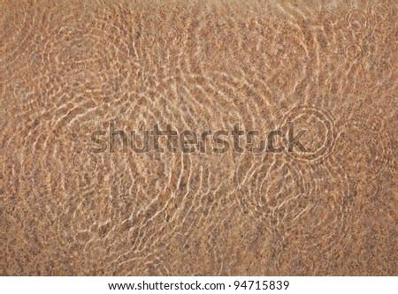 Circle water ripple on sand