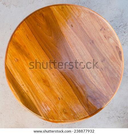 Circle Wood Table on a floor