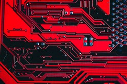 Circuit board. Electronic computer hardware technology. Motherboard digital chip. Tech science background. Integrated communication processor. Information engineering component. Red, orange color.
