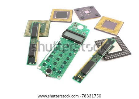 Circuit board (keypad) for cell phone with processors and RAM over white.