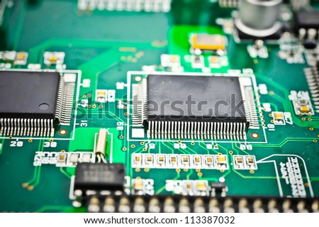 circuit board with electronic components macro background