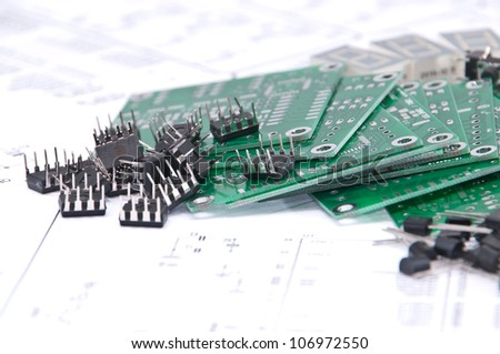Circuit boards and electronic components with schematics in background