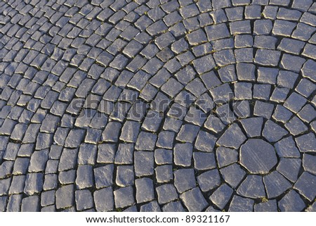 Circular detailed patterns of cobblestone make up Palace Square in St. Petersburg