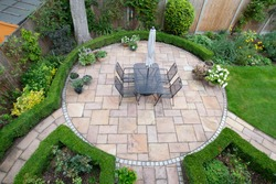 circular garden patio with freshly jet washed paving stones