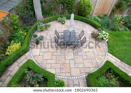 circular garden patio with freshly jet washed paving stones Stock photo ©